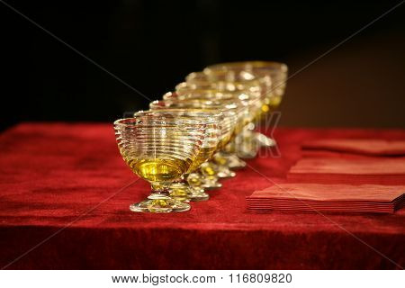 Set Of Glass Bowls Of Red Liquid On The Table