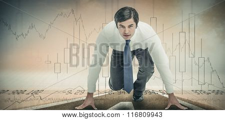 Tradesman in sprinting position against stocks and shares