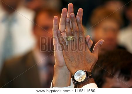 Raised Up And United Two Human Hands