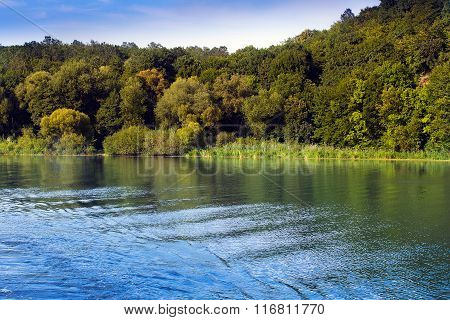 The River Aroundl Coastline Of Hills With Green Trees
