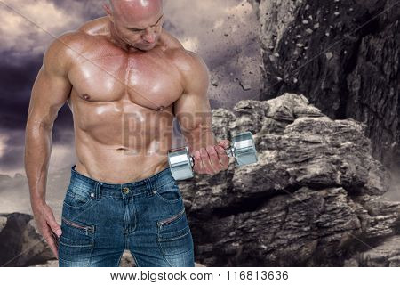 Bald man lifting dumbbells against rock crashing down from cliff
