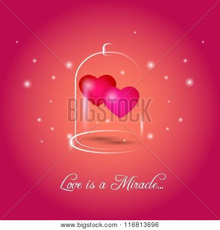Two red hearts in glass bubble