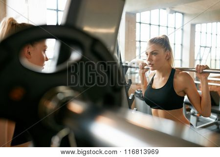 Young Woman In Gym Doing Squats