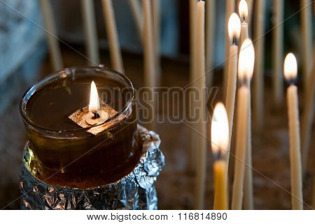 Church Holy Candle Burning In Oil