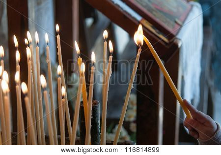 Lighting  A Church Candle