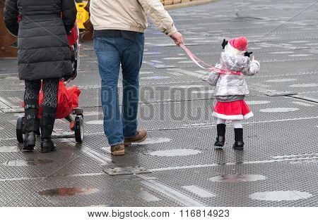 Family With Young Girl Walking In The Park