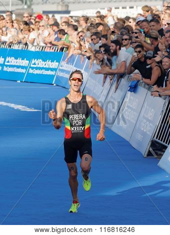 Smiling And Running Triathlete Joao Pereira Fighting At The Finish