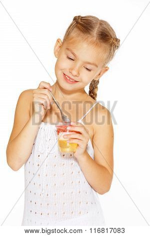 Little girl eating jello