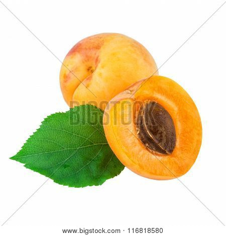 Apricot whole and half with green leaf