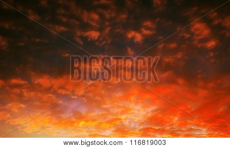 Pocked Fiery Sky At Sunset With Sun Rays
