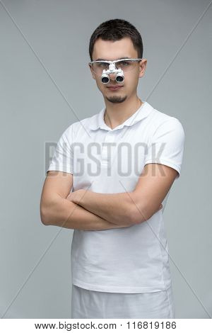 Doctor with binocular loupes