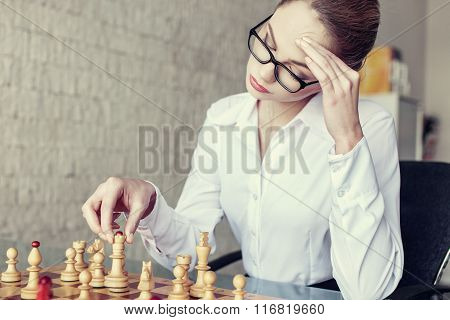 Businesswoman Thinking During Playing Chess