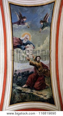STITAR, CROATIA - AUGUST 27: God gives Moses the Ten Commandments, fresco in the church of Saint Matthew in Stitar, Croatia on August 27, 2015