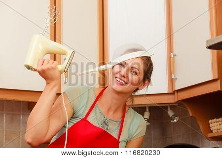 Housewife With Mixer Having Fun In Kitchen.