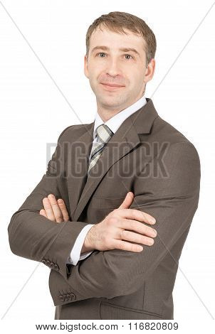 Businessman with crossed arms looking at camera