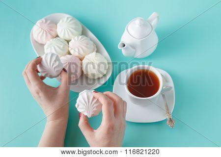 Women Take Vibrant Colored Marshmallow For Breakfast