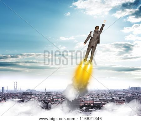 Businessman in suit flying