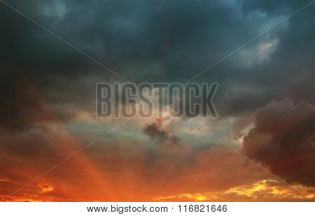 Rays At Sunset With Storm Clouds
