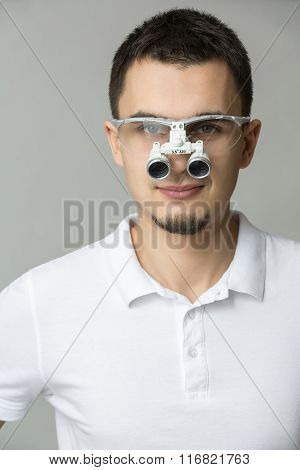 Dentist with binocular loupes