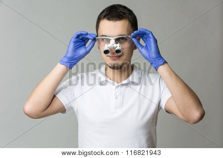 Dentist with binocular loupes