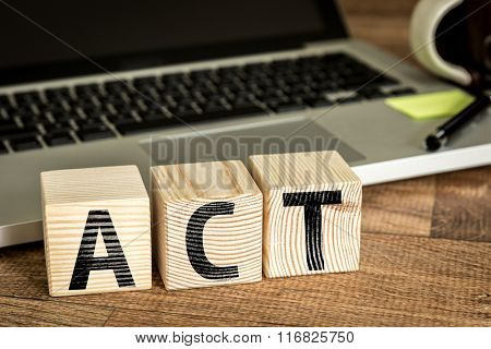 Act written on a wooden cube in a office desk