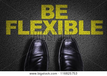 Top View of Business Shoes on the floor with the text: Be Flexible