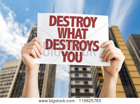 Destroy What Destroys You placard with urban background