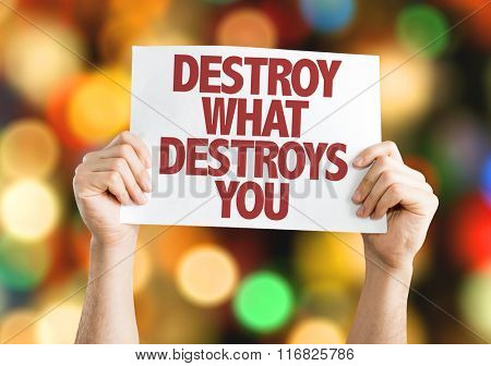 Destroy What Destroys You placard with bokeh background