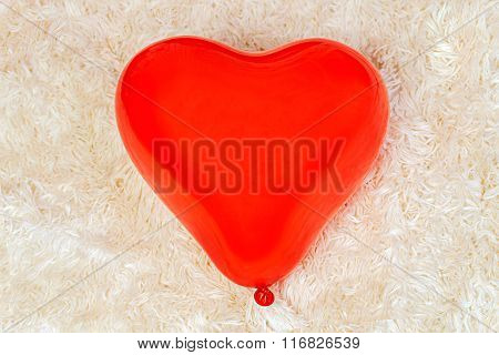 Red Balloon In The Shape Of A Heart