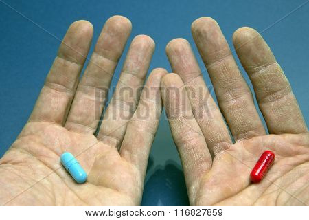 Hands With Capsule Red And Blue