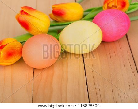 Colored Easter Eggs And Tulips