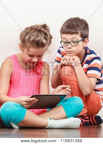 Kids Playing On Tablet.