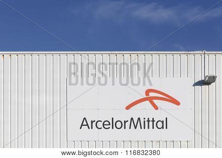 ArcelorMittal logo on a facade of a factory