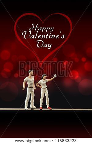 Miniature people -  a couple take a selfie to  celebrate Valentine's Day