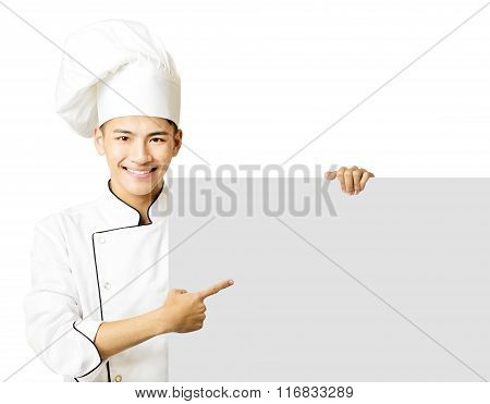 Young Chef Showing An Empty Board  Isolated On White