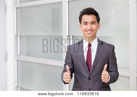 Asian Businessman Showing Thumb Up