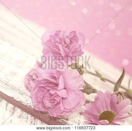 Pink Carnation Flowers On Rustic White Wooden Table. Valentine's Day And Mother's Day Background. Vi