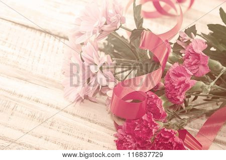 Bouquet Of Pink Chrysanthemum And Carnation Flowers On Rustic White Wooden Table. Vintage Toned Imag