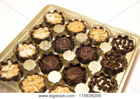 Delicious chocolate pralines in the golden box