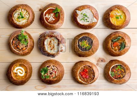 Twelve Soup Varieties Served In Bread Bowls