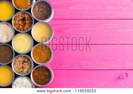 Open Cans Of Soup On Bright Pink Background