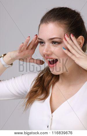 woman in white dress shouts