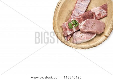 Top View Raw Pork On Wooden Dish.