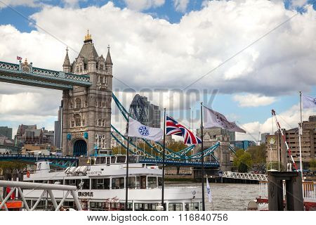 LONDON, UK - APRIL 30, 2015: Tower bridge and City of London financial aria on the background. View
