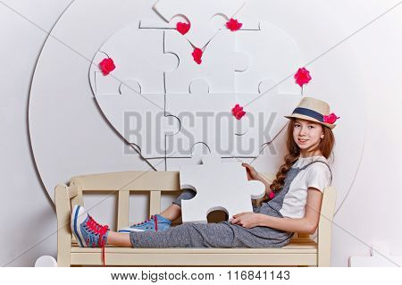 Teen Girl Sitting On A Bench.