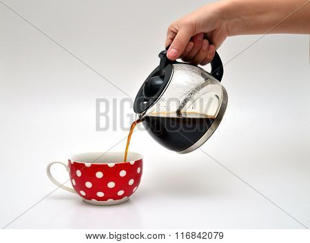 Pouring Coffee In A Cup