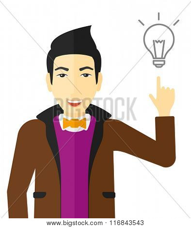 Man pointing at light bulb.