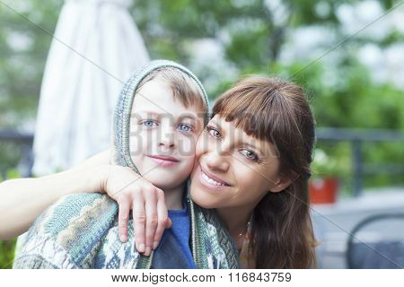 Portrait of an adorable mother hugging her boy
