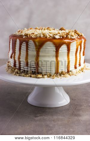 Cake Decorated With Salted Caramel Sauce And Nut