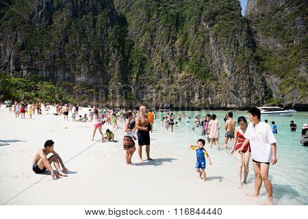 PHI PHI ISLANDS, THAILAND - CIRCA FEBRUARY, 2015: Tourists relax on the beach of Maya Bay on Phi Phi Leh island. It starred the famous movie The Beach with the actor Leonardo DiCaprio